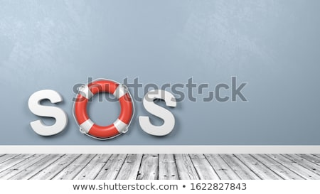 lifebuoy on wooden floor against wall stock photo © make