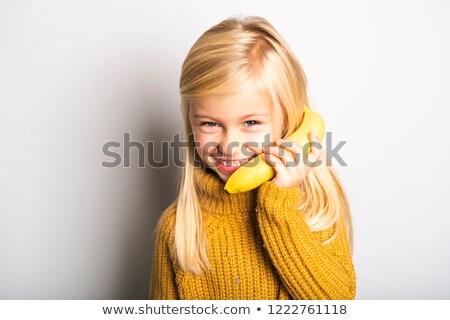 aranyos · lány · 5 · éves · pózol · stúdió · banán - stock fotó © Lopolo