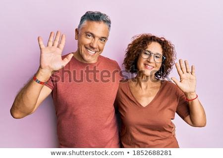 Kép örömteli pár lezser visel mosolyog Stock fotó © deandrobot