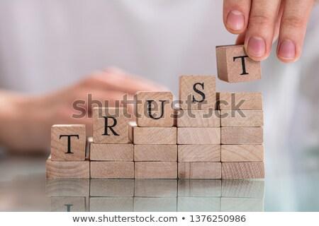 Kéz utolsó ábécé szó bizalom fából készült Stock fotó © AndreyPopov