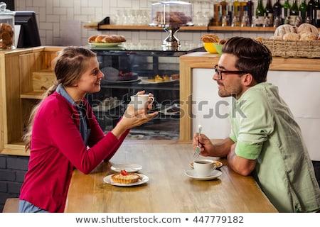 Romantic couple sitting at spectacle Stock photo © ra2studio