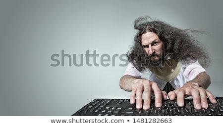 Divertente ritratto magro nerd lavoro computer Foto d'archivio © majdansky