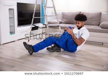 Erkek düşen merdiven el ulağı ev çalışmak Stok fotoğraf © AndreyPopov