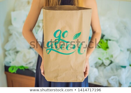 человека · пакет · зеленый - Сток-фото © galitskaya
