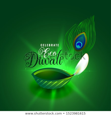 eco diwali concept with green diya and peacock feather design stock photo © sarts
