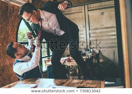 dos · jóvenes · empresarios · argumento · oficina · cara - foto stock © andreypopov