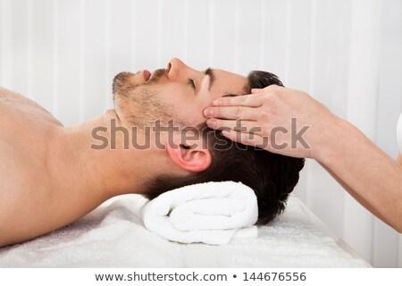 A torso nudo uomo trattamento termale massaggio luogo sorriso Foto d'archivio © Lopolo