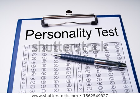 Personality Test Sheet And Pen With Clipboard Over Table Stock photo © AndreyPopov