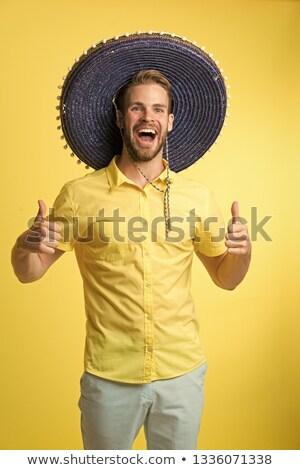 Gülme adam geniş kenarlı şapka şapka mutlu aptal Stok fotoğraf © nomadsoul1