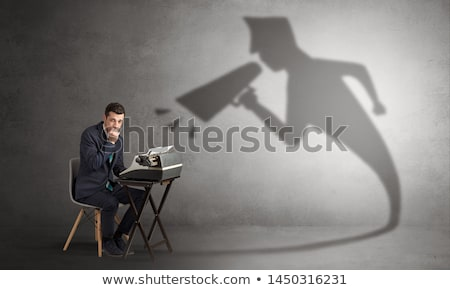 Imprenditore ombra lavoro suit desk Foto d'archivio © ra2studio