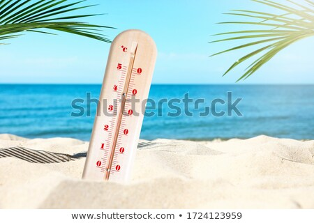 Thermometer On Sandy Beach Stock photo © AndreyPopov