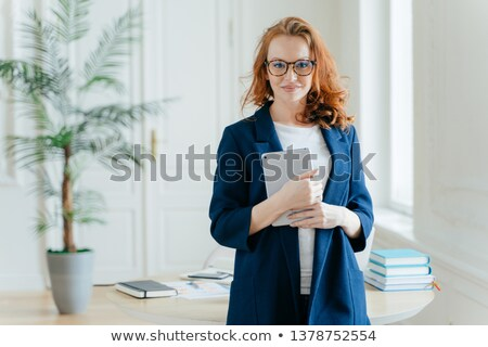 Caucasian businesswoman holds tablet computer, checks balance account, wears optical glasses and for Stock photo © vkstudio