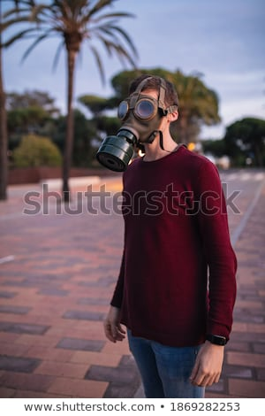 man with gas mask surviving COVID19 in the street Stock photo © Giulio_Fornasar