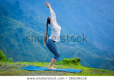 Young sporty fit woman doing yoga oudoors in mountains Stock photo © dmitry_rukhlenko