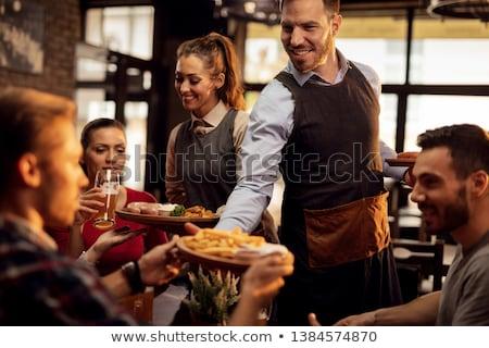 Pincér nő adag csoport barátok étel Stock fotó © boggy