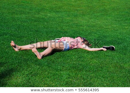 lying down baby girl holding shoes Stock photo © phbcz