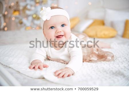 Glimlachend zeven maand oude witte bloem Stockfoto © JamiRae
