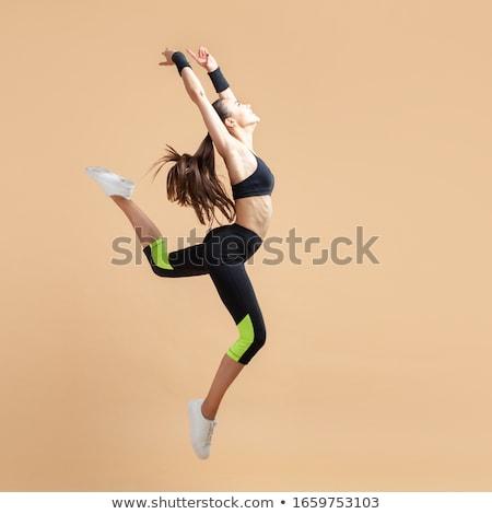 Tánc nő sportruha ugrás nyújtott kéz Stock fotó © Paha_L