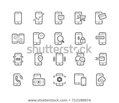 Cep telefonu dolar para yalıtılmış beyaz iş Stok fotoğraf © stokato