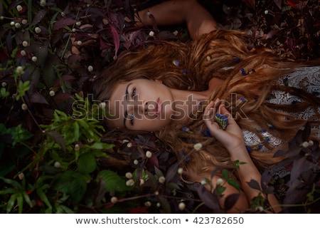 woman lying in flowers Stock photo © smithore