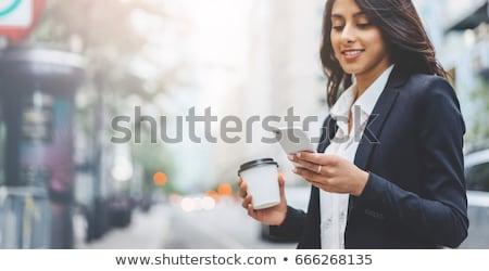 красивой деловой женщины телефон современное здание улице бизнеса Сток-фото © HASLOO