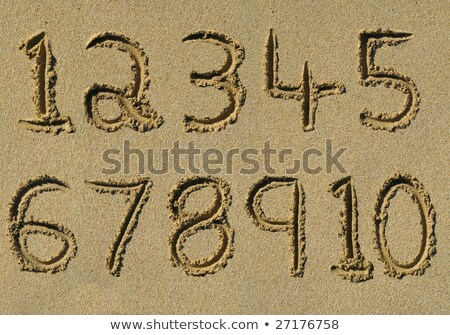 numbers one to ten written on a sandy beach stock photo © latent
