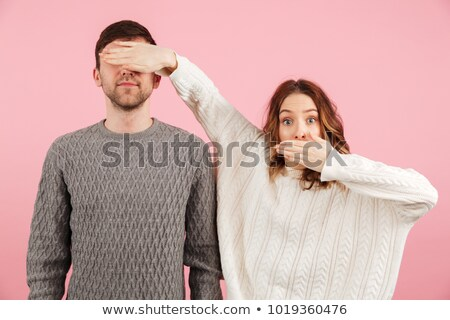 Woman with her hands over a man's eyes Stock photo © photography33