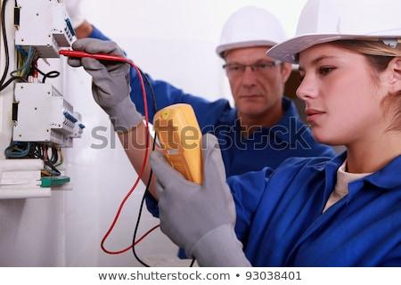 Tradeswoman using a multimeter Stock photo © photography33