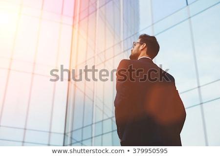 Büszke üzletember haj öltöny portré sötét Stock fotó © photography33