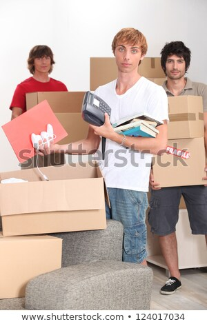 Three lads packing up and moving home Stock photo © photography33