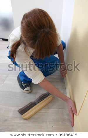 Woman smoothing down wallpaper Stock photo © photography33