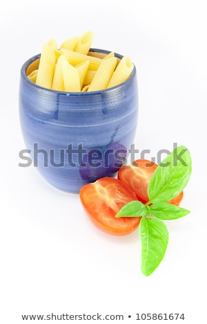 Pens pasta in a blue jar with tomatoes and basil stock photo © Armisael