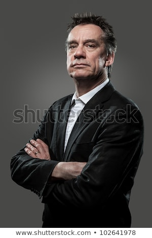 Handsome Stern Business Man High Contrast on Grey Background stock photo © scheriton