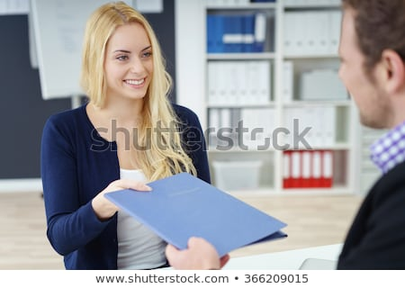 Woman handing over files to her female boss Stock photo © stockyimages