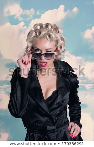 Beautiful winking pinup girl Stock photo © phakimata