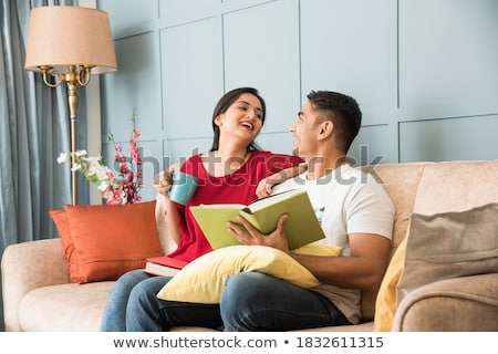 Woman reading a book while drinking a cup of tea Stock photo © photography33