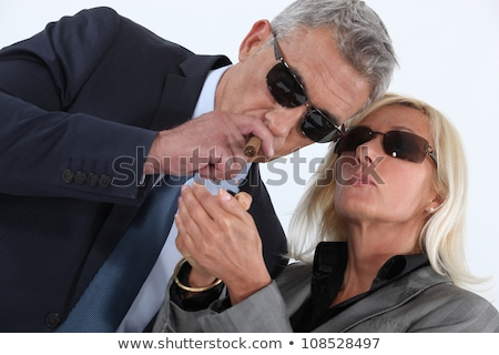 mature gentleman smoking cigar with blonde spouse showing off Stock photo © photography33