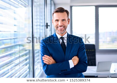 Businessman standing in the corner Stock photo © RTimages