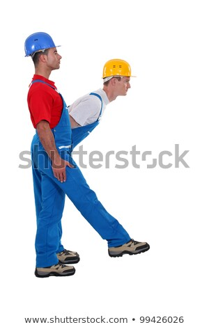 Two laborer standing in shape of K letter Stock photo © photography33