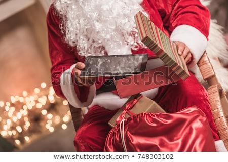Digital tablet with christmas present stock photo © manaemedia