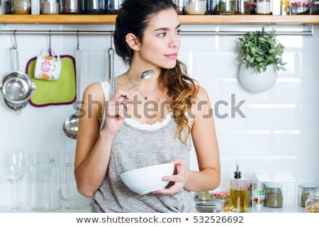 Jonge vrouw genieten ontbijt ondergoed roze shirt Stockfoto © studiofi