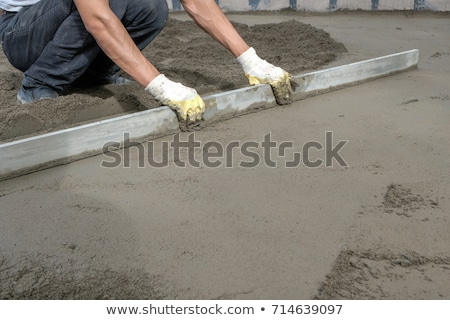 Builder smoothing a concrete foundation Stock photo © photography33