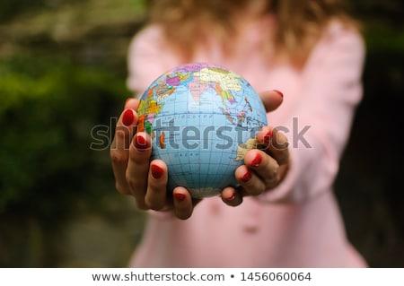Młoda kobieta mały świecie strony świat Zdjęcia stock © photography33
