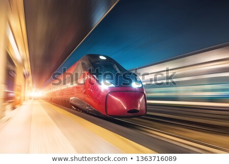 railway station with train in movement stock photo © abbphoto