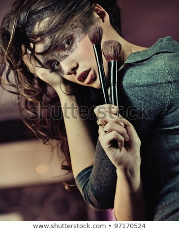 portrait of a loving couple with make up brush stock photo © konradbak