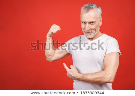 male bodybuilder showing his biceps Stock photo © Jasminko