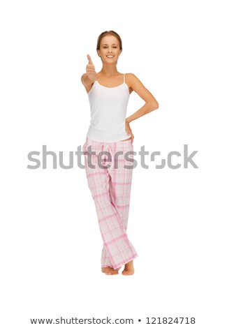 woman in cotton pajamas showing thumbs up Stock photo © dolgachov