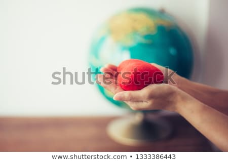 close up of jesus christ holding heart shape stock photo © zzve
