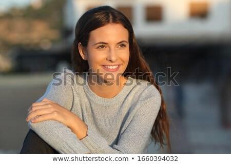 Brunette lady staring at beautiful sunrise Stock photo © konradbak