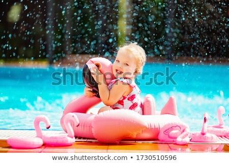 blonde playing with duck float stock photo © kakigori